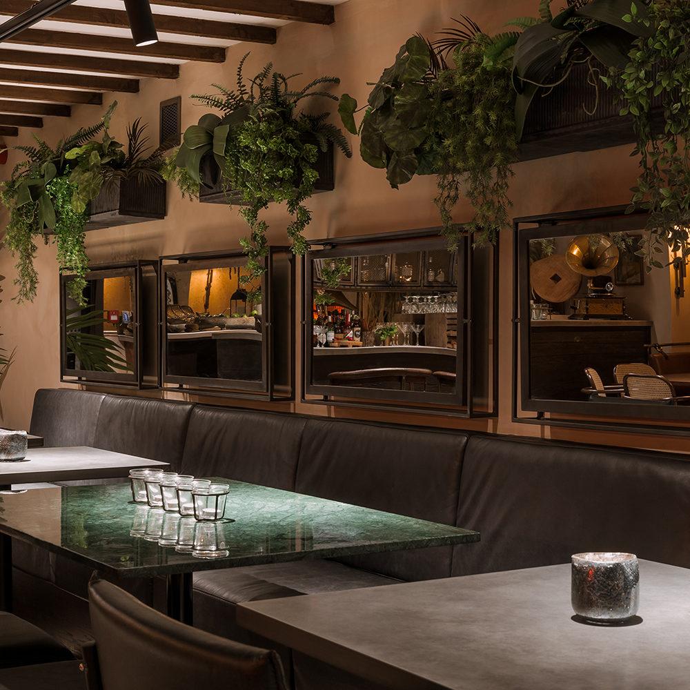 khai-khai-banquette-interior-design-planting-mirror-marble-table